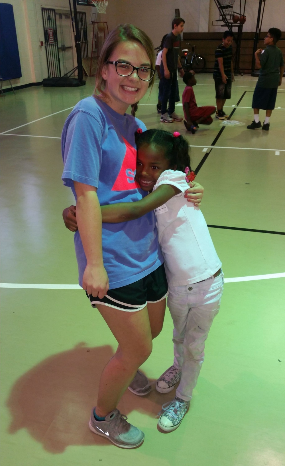 Ally getting a hug from Cherise at Dream Center Ybor City