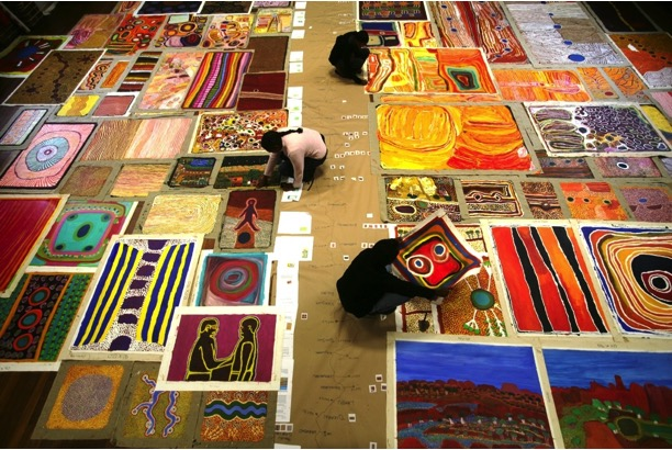 Aboriginal co-curators Louise Mengil, Hayley Atkins and Murungkurr Terry Murray at work, 2008