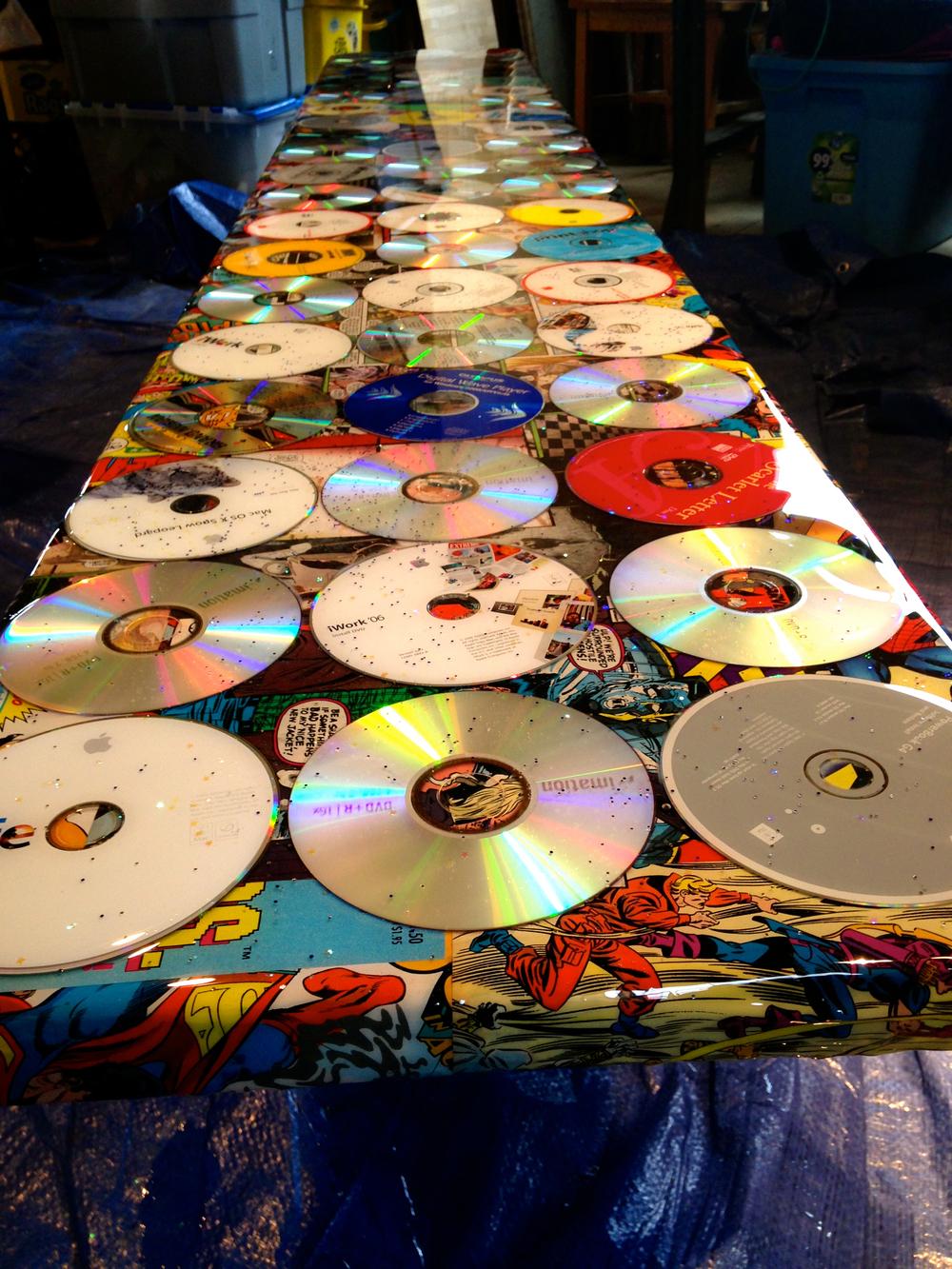 """Salvaged Comics & CD's Bench"" Assemblage by Shelita Birchett Benash"