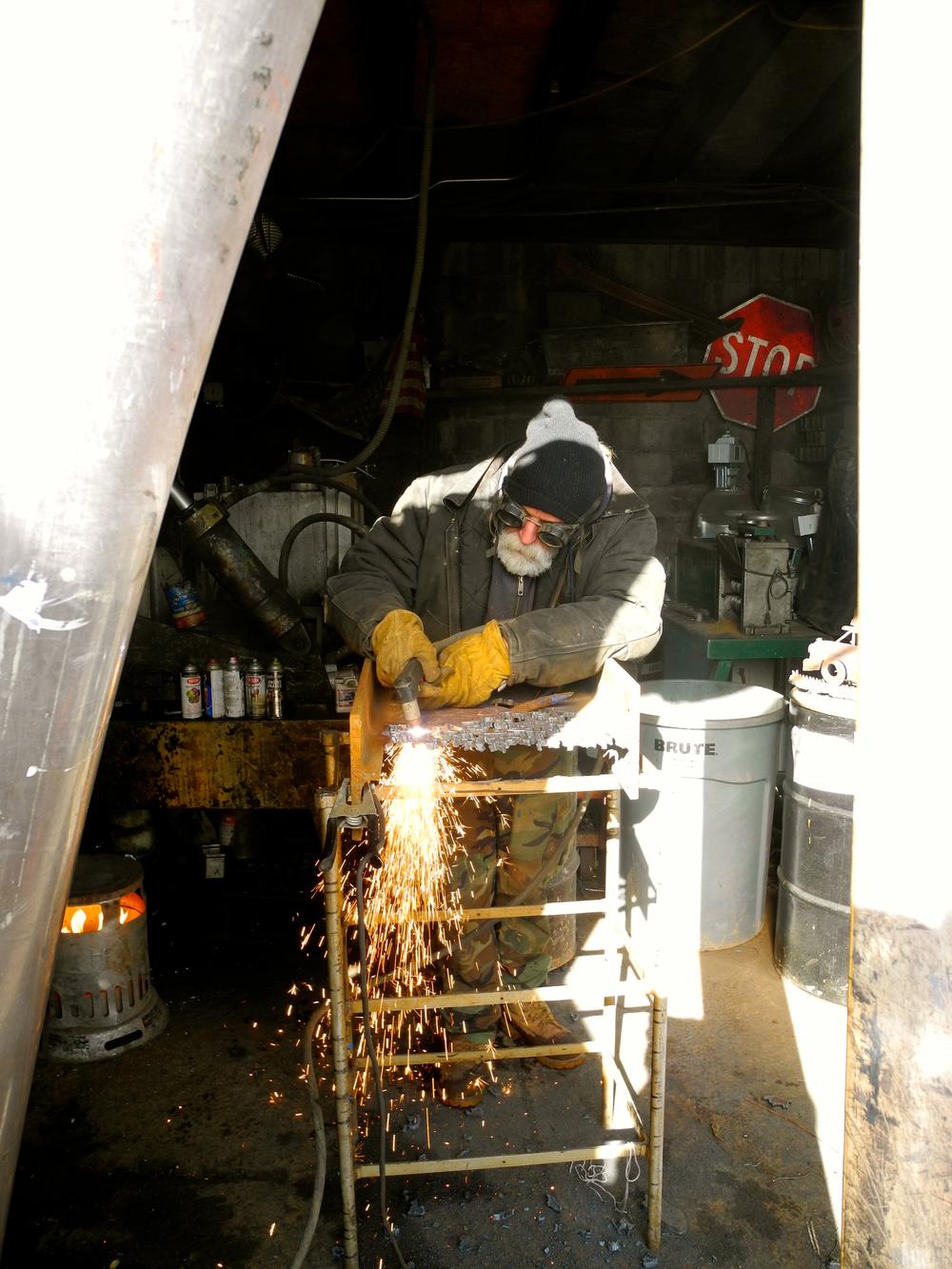 Richard in his junk yard studio.