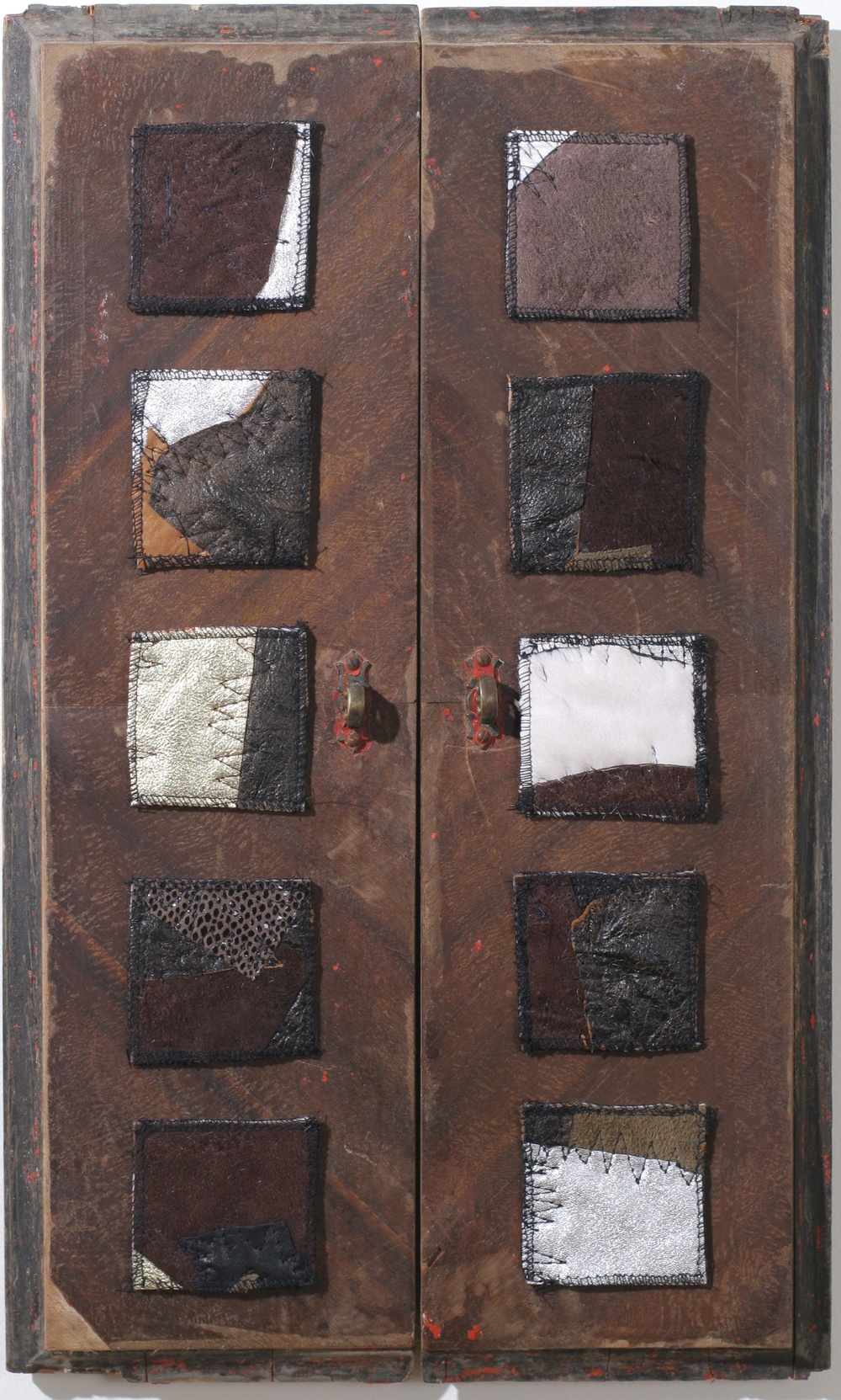 """Doors,"" Leather quilts and doors salvaged from an antique chest. 2006."