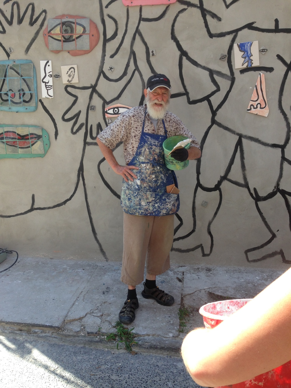 The Isaiah Zagar mural workshop began with a lesson in how to properly cut and break glass. Then onto the mural site in Northern Liberties, where Zagar instructed us on how to butter the back of the glass and apply it to the mural wall.