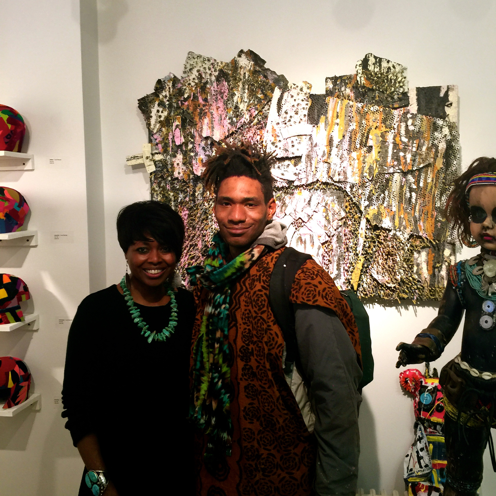 "Shelita Birchett Benash, curator and multi-media artist, Calving Brett; pictured with ""The March to Elsewhere."" Calvin travelled from North Carolina for the opening of the ""Out of Bounds: Freedom of Expression"" exhibition. 2/15/15"