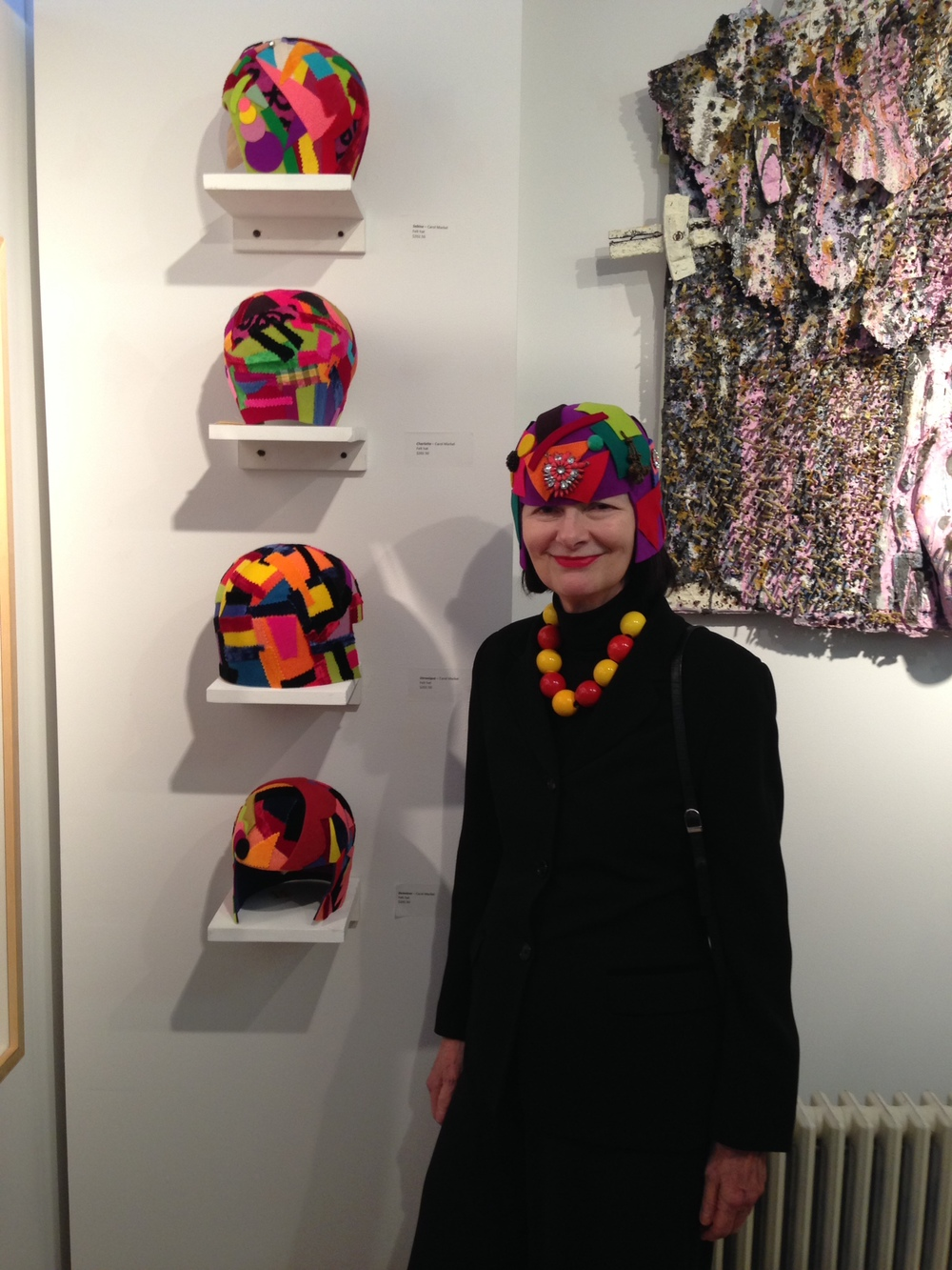 Carol Markel with her fabulous hats at the Out of Bounds opening reception at Blue Door Gallery.