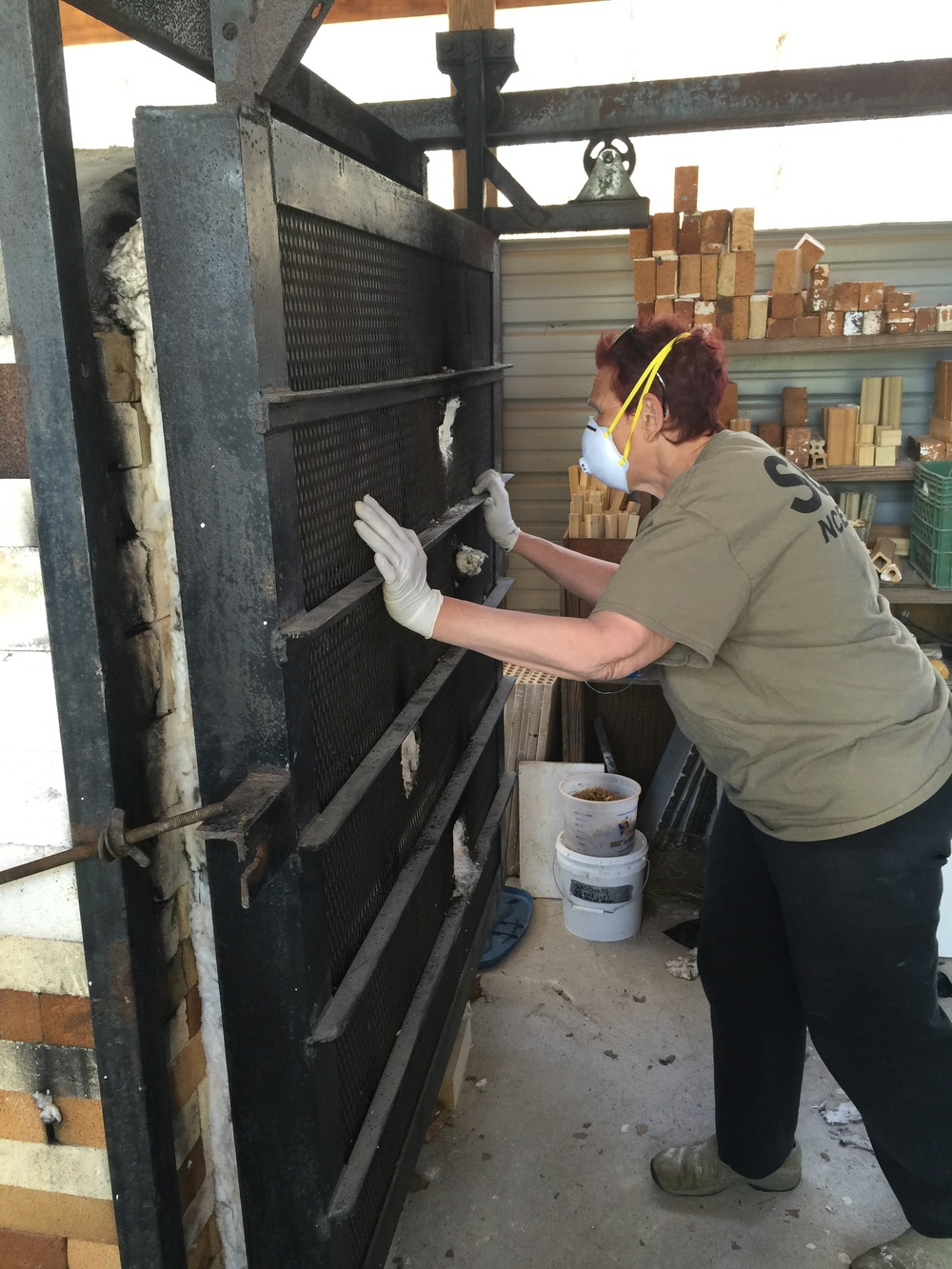 Lynn Isaacson at her New Prospect Pottery Studio. Her gas reduction kiln is brutal!