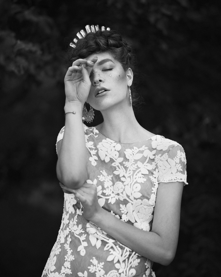 Black and white photo of calgary fashion model in white lace dress