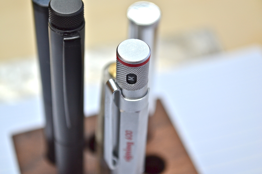 this is a silver rotring 600 fountain pen with other rotring pens