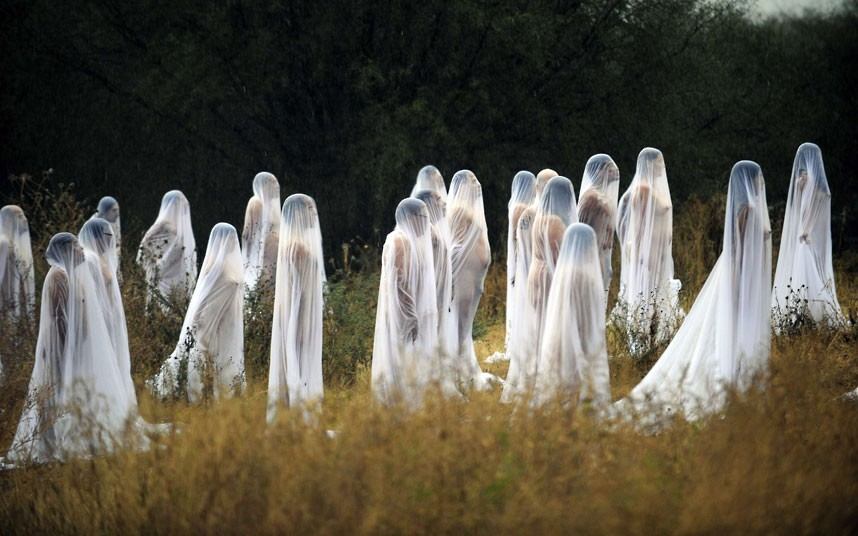 phototoartguy :     Naked volunteers perfom for US photographer and artist Spencer Tunick at Los Senderos Villages in San Miguel de Allende municipality, Guanajuato State, Mexico to mark the Day of the Dead   Picture: ALFREDO ESTRELLA/AFP/Getty Images