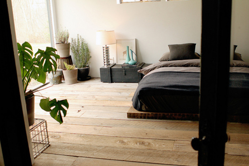 Don't accidentally kick that bed platform with bare feet.  Looks lovely, though!