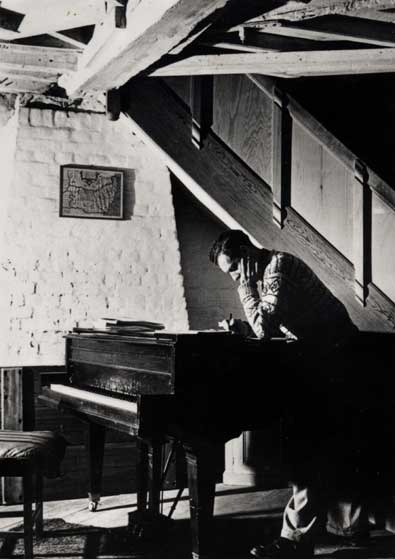 sisterspock: classicalliterature: Benjamin Britten at his piano in The Old Mill