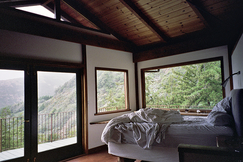 this is a bit similar to the bedroom of my ledge-side house, north lodge.  the peaked wood ceiling is a great idea.