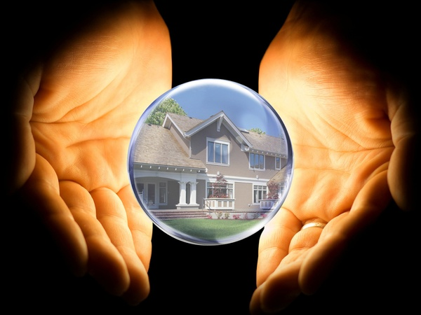 crystal-ball-with-house-in-it-being-held-by-hands_085152.jpg