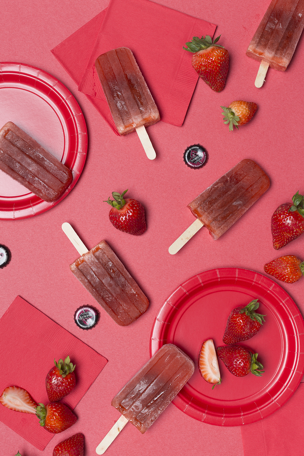 Strawberry Sangria Popsicles! This idea randomly came to me the other day... And I wasn't sure how it was going to turn out. 😁 I think you'll really like them! I was super surprised! My husband loves them too... And that's saying something as he's not the huge fan of fruit puréed popsicles. He's more of a frozen apple juice kinda guy. 😄       Strawberry Sangria-   16oz Package hulled Strawberries    2-11oz Sangria Senorial bottles   1/4C sugar       Add all ingredients to a pot, and bring to a boil. Let boil for 2 min, turn heat down and let mixture simmer until strawberries are soft. Let mixture cool. Blend together. After blended, let mixture sit for a few min, the mixture will separate. Stir together with a spoon, then fill molds, freeze, and enjoy!