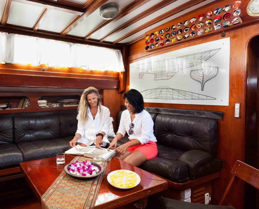 Relaxing in saloon during charter cruise on yacht Scame.jpg