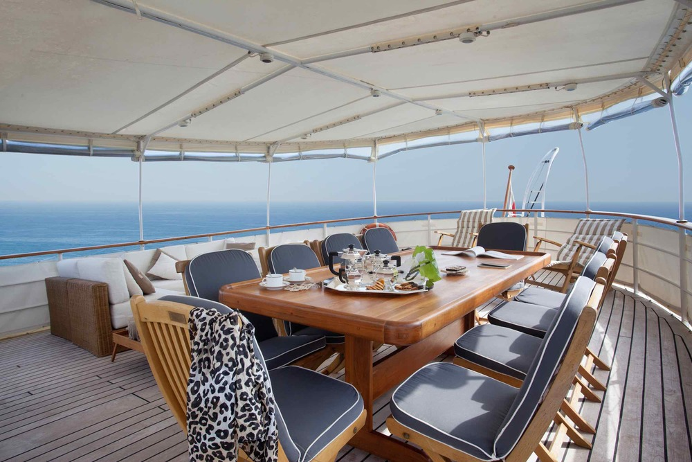MY Drenec deck dinner table private yacht charter burma.jpeg