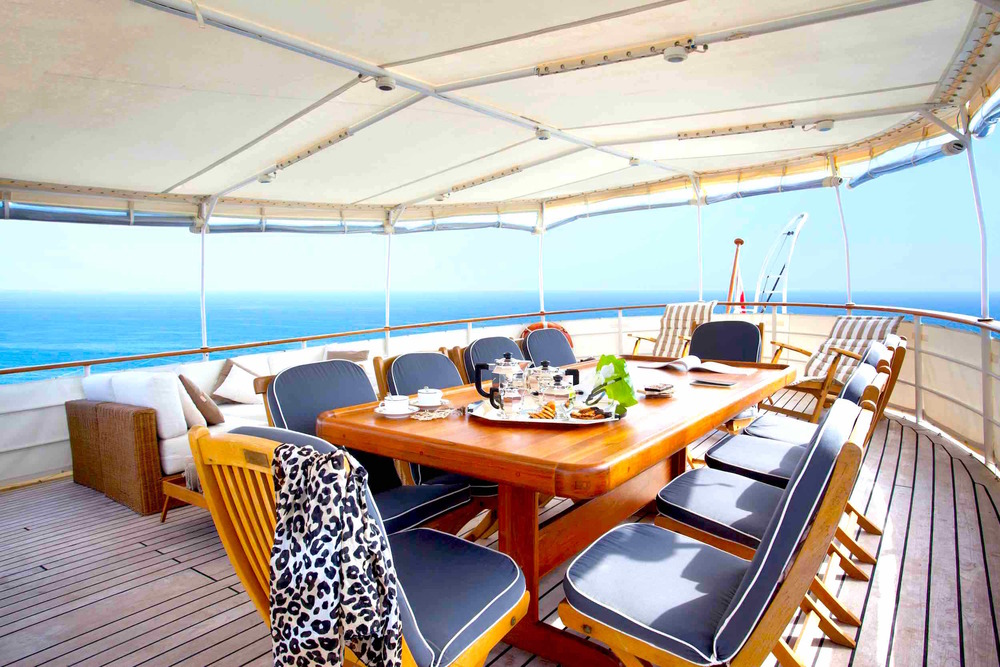 MY Drenec deck dinner table private yacht charter burma copy.jpeg