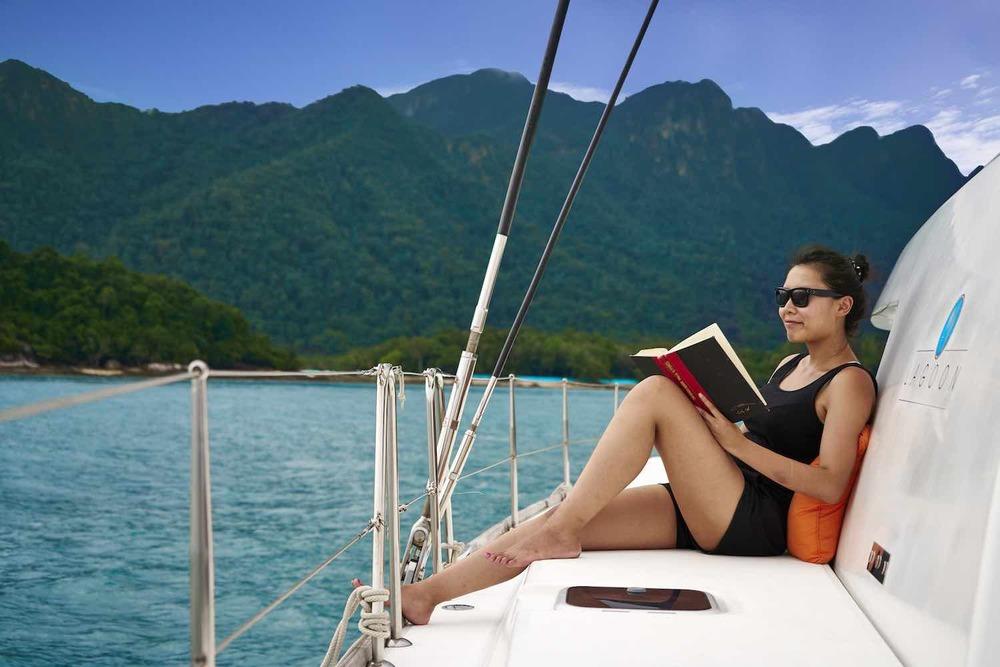 Meltemi reading on deck XS.jpeg