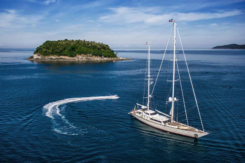 Clan VI_sailing on rippling waters toward an island_XS.jpeg
