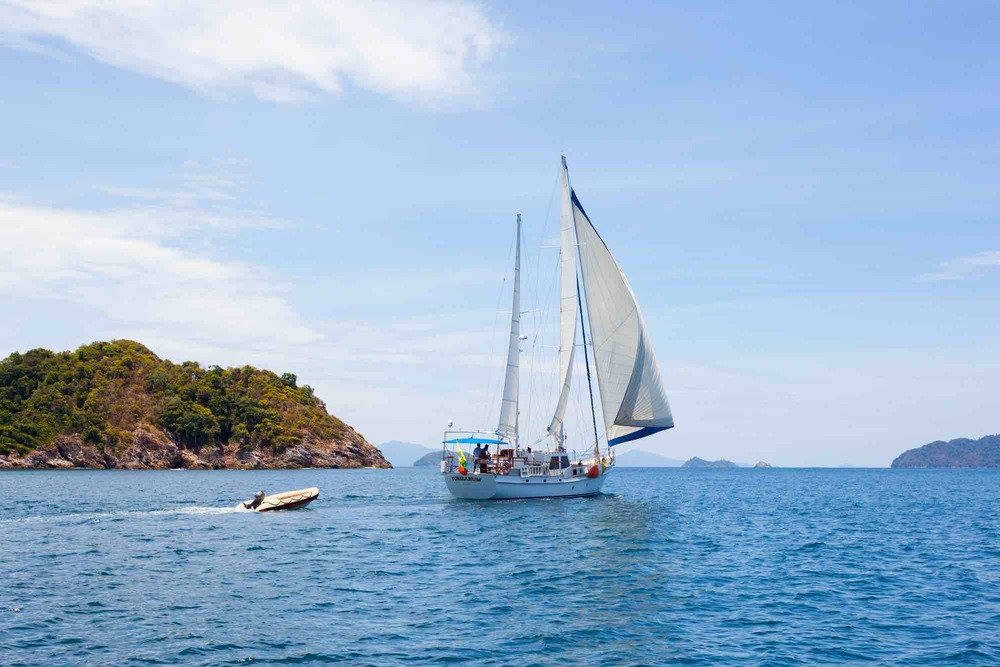 Jubilaeum_sailing full sail away from an island-tender sailing around in Mergui_XS.jpeg