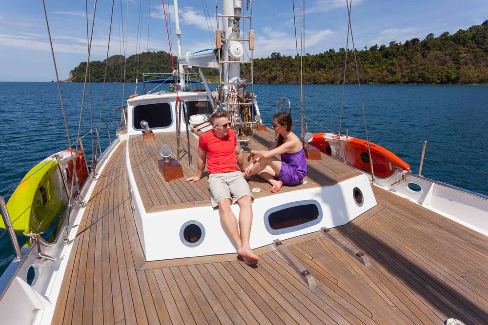 Jubilaeum_guest couple relaxing on deck lounge sailing in Mergui_XS.jpeg