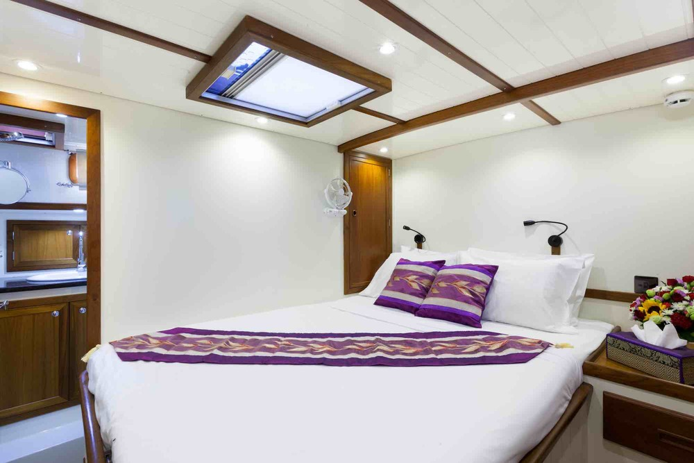 Dallinghoo_guest cabin sweet home on yacht pink throw pillows sailing in Mergui 1_XS.jpeg