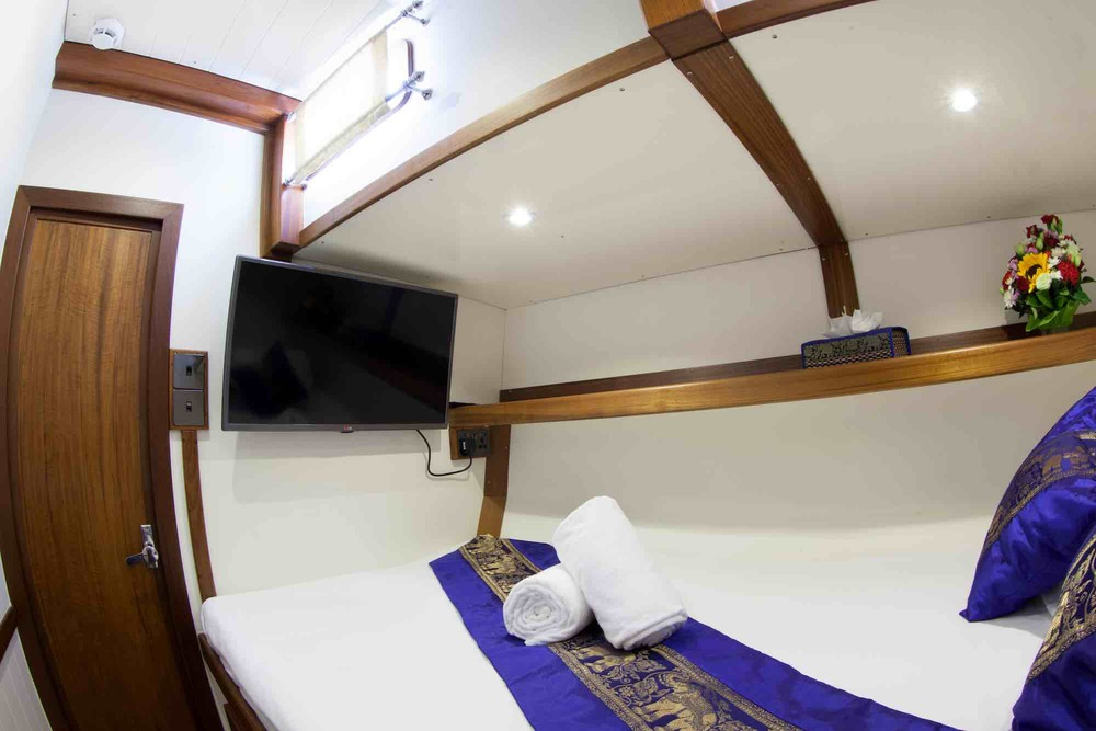 Dallinghoo_guest cabin sweet home on yacht purple throw pillows and TV sailing in Mergui_XS.jpeg