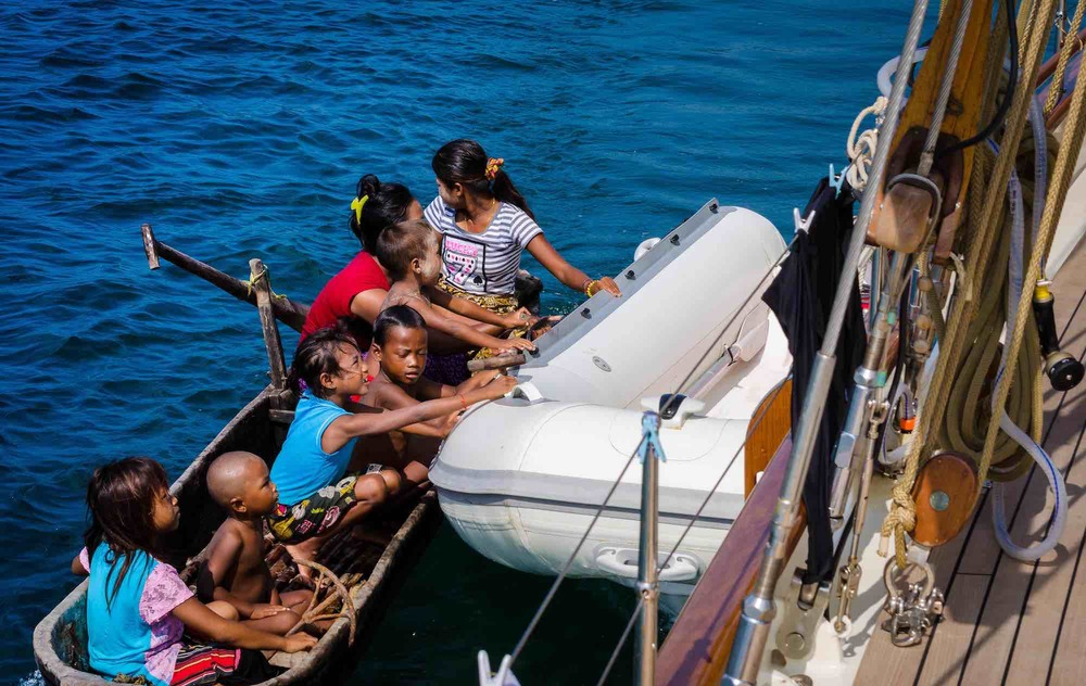Dallinghoo_local kids holding on to yacht tender sailing trip in Mergui_XS.jpeg