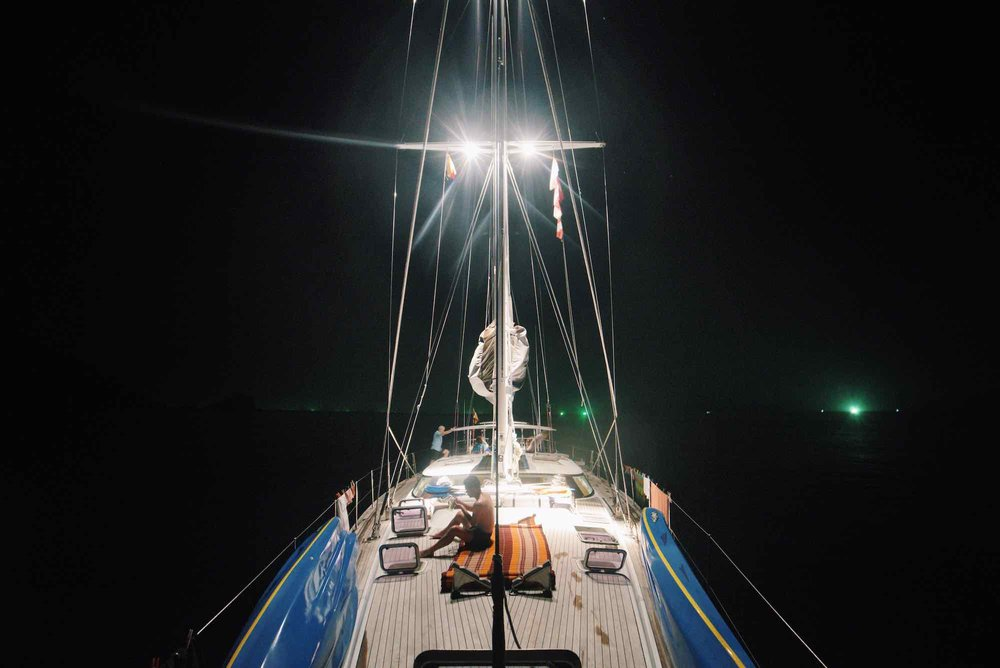 Y Not_well lighted yacht at night anchoring near islands in Myanmar's Mergui_XS.jpeg