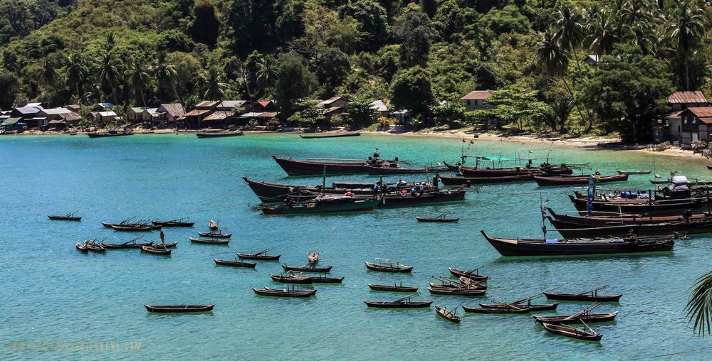 Burma Boating_arrays of fish boats near the beach.jpeg