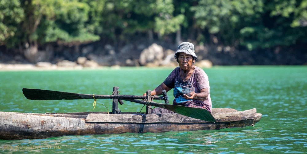 Burma Boating_Moken woman rowing wood canoe.jpeg