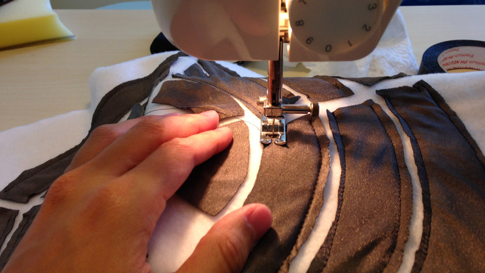 Sewing the pieces of conductive fabric on Prototype v.3.