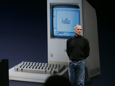 Steve Jobs and an old mac
