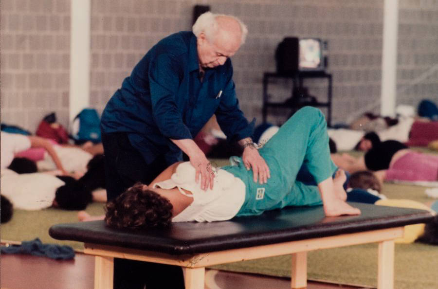 Dr. Feldenkrais demonstrating with a student.