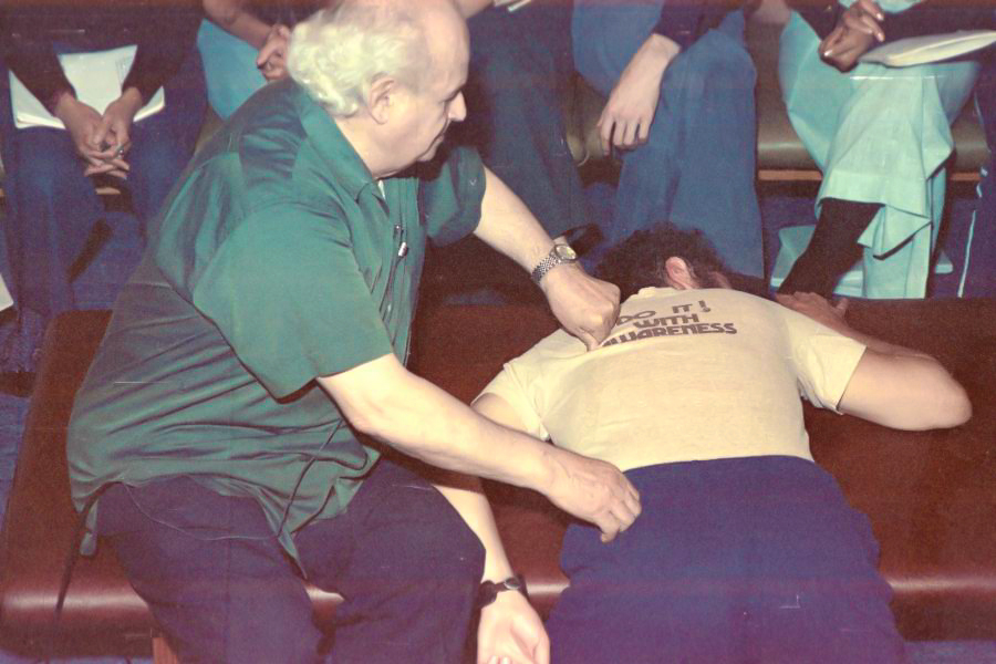 Feldenkrais demonstrating with a Student