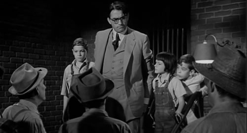 Atticus Finch and the children are confronted by the lynch mob