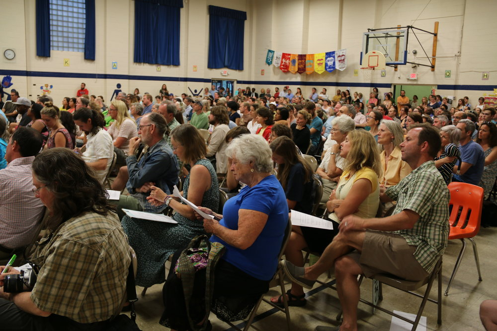 A crowd of 600 parents, students, teachers, and community members. All members of City Council and a representative from Duke Energy were in the audience.