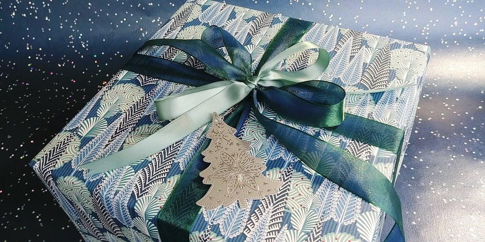 Simple and gorgeous wrapping is easy with the right combination of paper and ribbon.  December 1, 2018