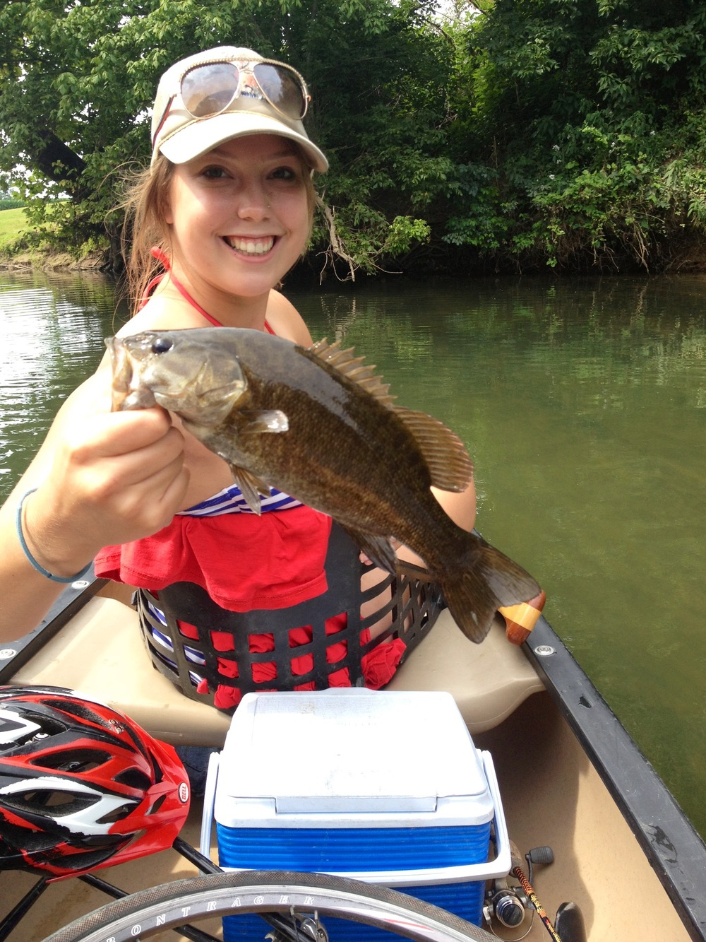Lindsey with a beautiful Shenandoah small mouth.  note the bicycle wheel peaking out of the bottom of the canoe!