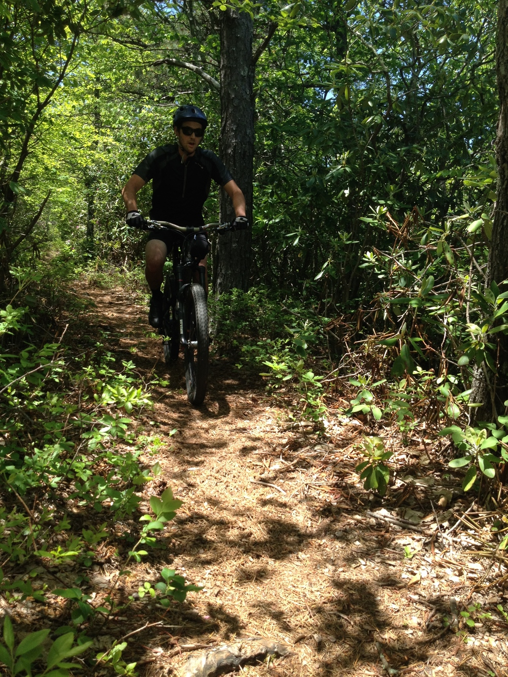 Sam Skidmore Rolling through some piney trail Photo Credit: Erik Jensen