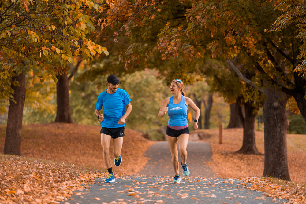 Bluestone Ambassadors Isaac and Nelle running on the Bluestone Trail in Purcell Park.