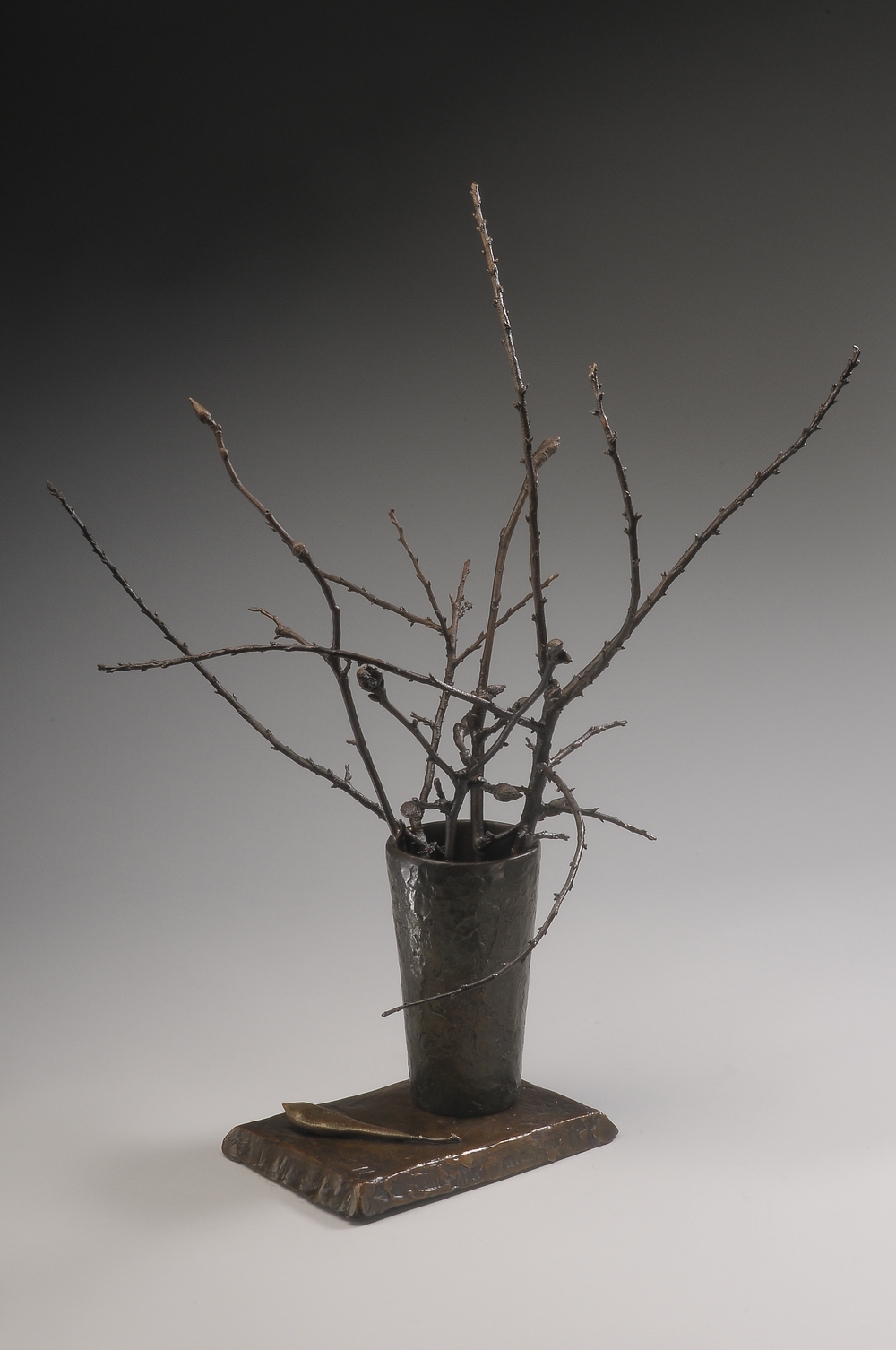 "Beach Plums and Magnolia  , Ellen Lewis Watson.  22"" x 16"" x 17"", bronze"