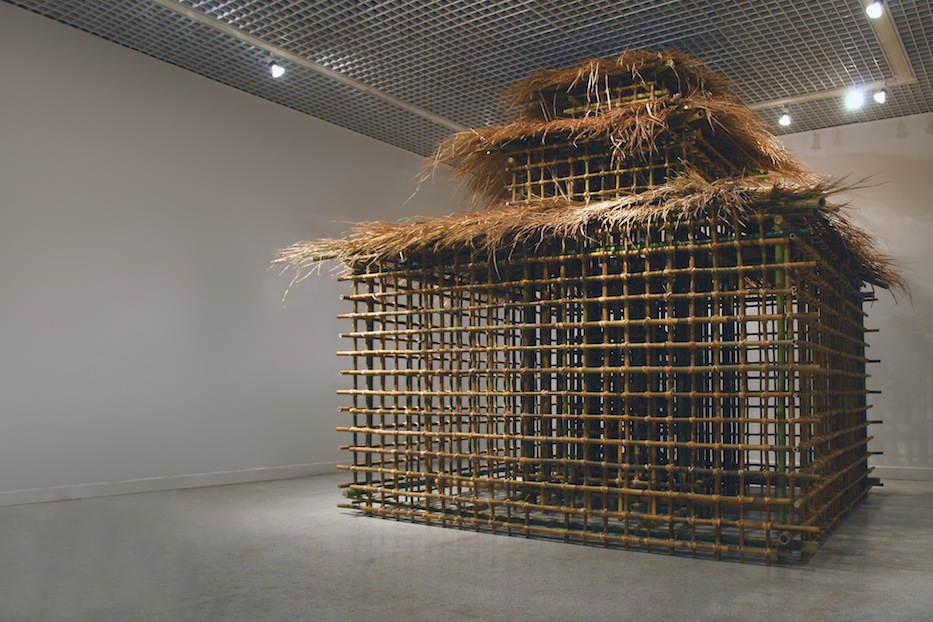 "Bamboo House  ,  Joan Backes, 2007-2012    14'2"" x 13'5"" x 12'5"" bamboo, reed, images on recycled paper"