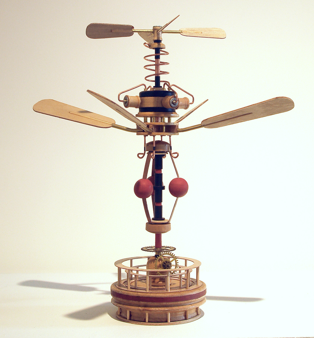 """Elicottero""                    Richard Whitten, 2013        Mixed Media: wood, copper wire, copper            sheet, copper and brass tubing, nylon and         brass bushings, steel weight, brass                  bushings, steel washers, paint        11.5"" x 10.75"" x 10.75"""