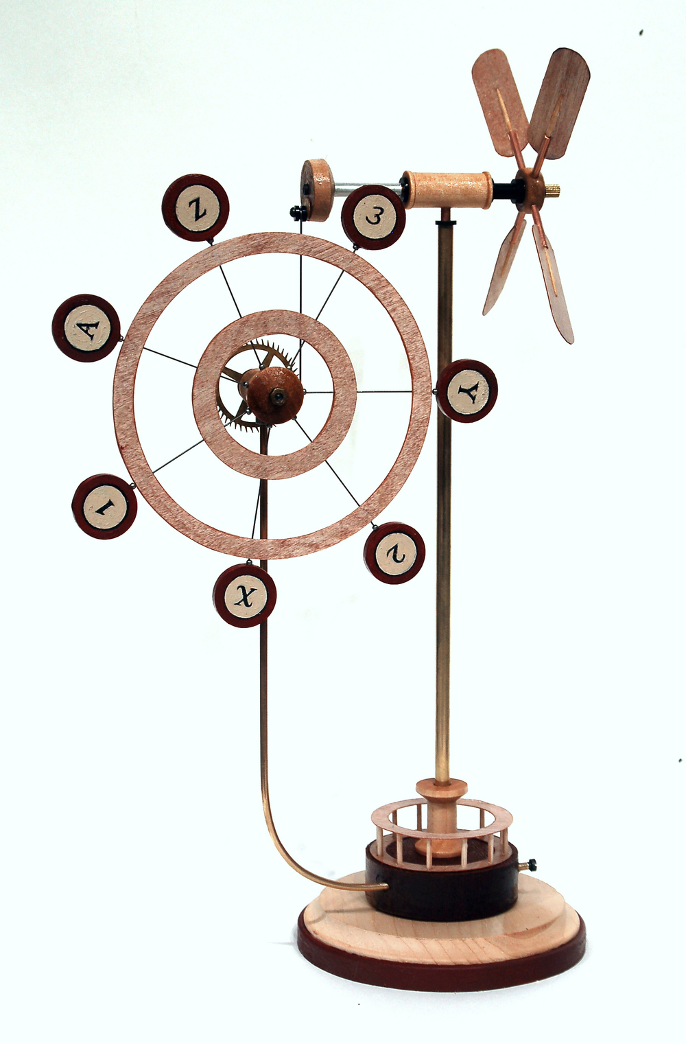 "Mechanism for Measuring the Velocity of             Wind in Paintings IV        Richard Whitten, 2014        Mixed Media: wood, steel wire, brass and         aluminum tubing, nylon bushing,                      brass gears and screws, paint        15"" x 9"" x 5"""