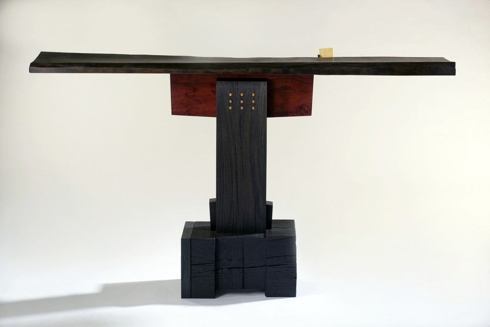 "Mad Rush    Gail Fredell, 2012       33"" high x 11"" wide x 57"" long    Cherry, white oak, yellow satinwood"