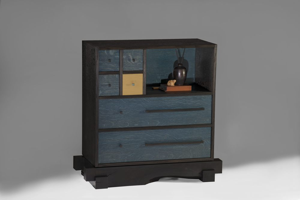"Tansu Blue    Gail Fredell, 2014    33-1/2"" high x 13-1/2"" deep x 34"" long    Blackened and painted oak, yellow satinwood, alder, steel & bronze handles"