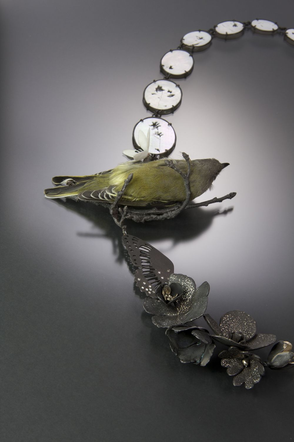 "Two Birds (detail)    Kelly Jean Conroy, 2013  20"" x 8"" x 1.5""  Sterling silver, bronze, copper, bone, mother-of-pearl, cubic zirconia, preserves vireo, sparrow skeleton"