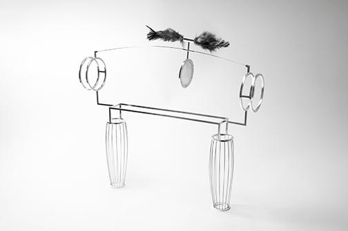 """Artifice: Exchange    Nick Heyl,2015  15"""" x 3"""" x 10""""  925 silver, brass, steel, feathers, silk organza"""