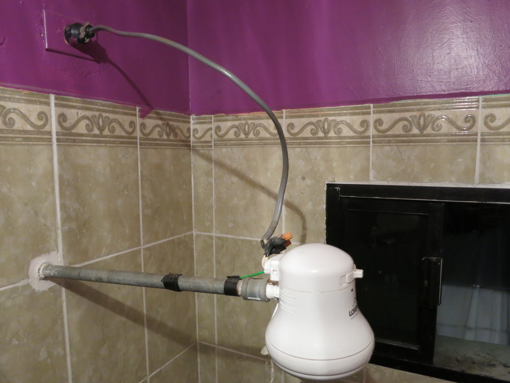 This is called the suicide shower. Note the heavy gauge wire twist tied