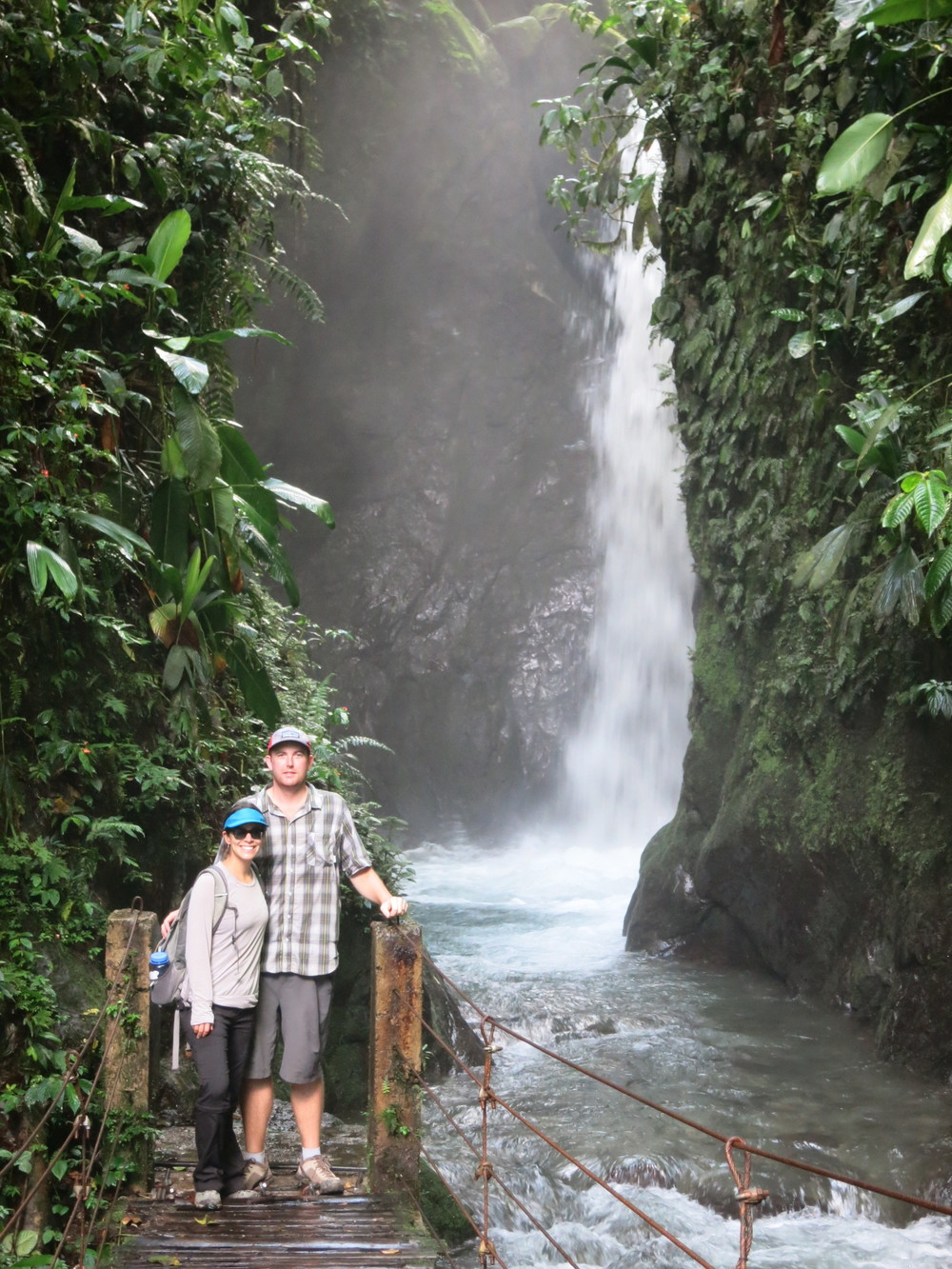 In front of one of the many waterfalls
